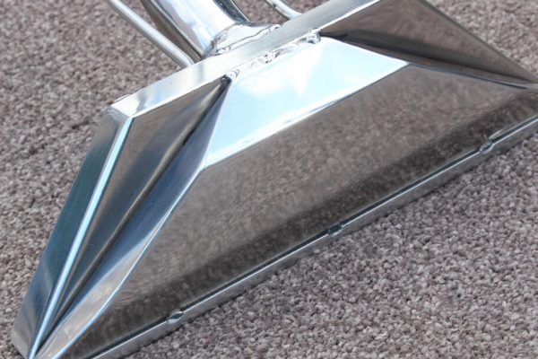 Picture of the carpet cleaners wand on a carpet.