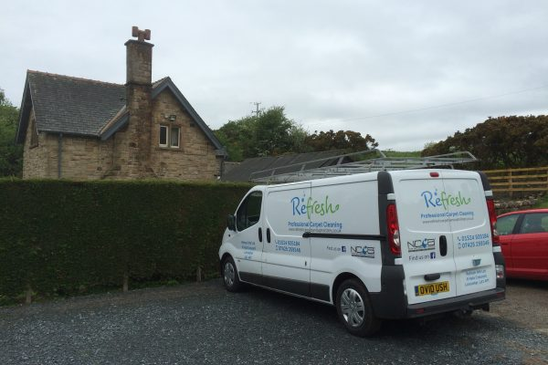 The Refresh carpet and upholstery cleaning van parked outside a house. Looking very professional.