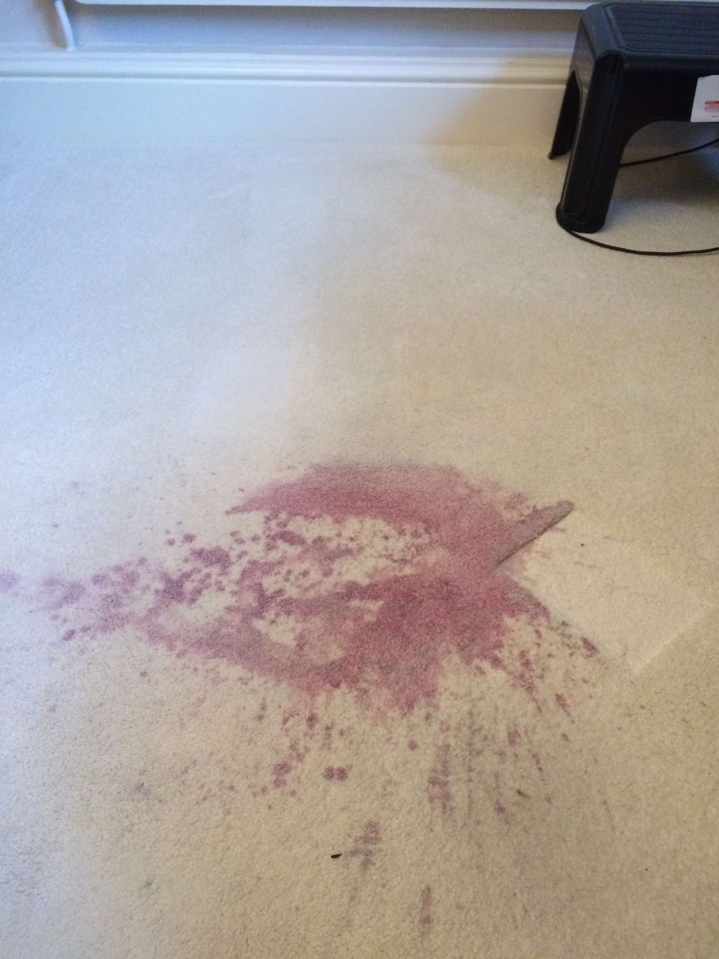 Large red wine stain splash on a cream carpet in Morecambe.